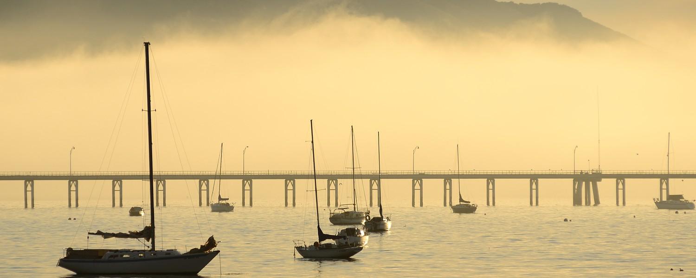 Several boats in the marina in San Luis Obisbo Bay near Pismo Beach and Avila Beach CA