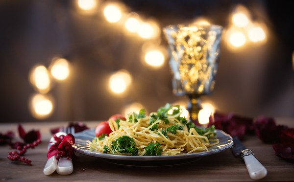 Italian pasta and glass of wine on wooden table